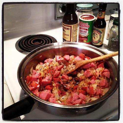 Add garlic, smoked sausage and seasonings