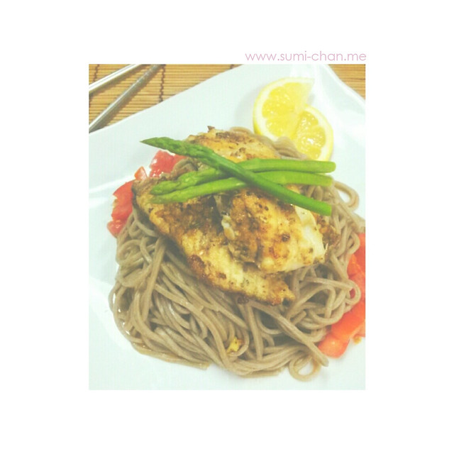 Pan-fried tilapia on cold soba noodles with tsuyu, tomatoes, asparagus and lemon slices