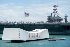 Sailors aboard USS John C. Stennis (CVN 74) render honors while passing the USS Arizona Memorial in June when arriving at Pearl Harbor for exercise Rim of the Pacific. (U.S. Navy/PO2 Ryan J. Batchelder)