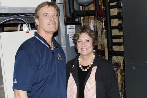 Freeborn Lumber Company owner John Miller and USDA Rural Development State Director Colleen Landkamer inside the room that operates Freeborn's geothermal system.  The system was installed with support from USDA Rural Development.