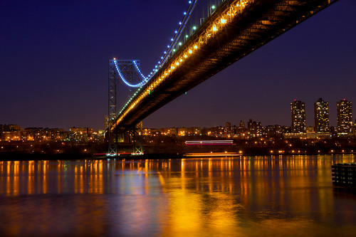 nyc newyorkcity longexposure nightphotography bridge newyork tourism water night reflections river gold newjersey cityscape shine view scenic le citylights hudson lighttrails gwb fortlee georgewashingtonbridge necklacelights