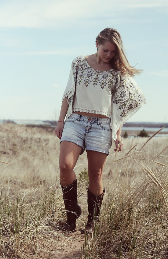 Top:  Free People;  Shorts:  Calvin Klein;  Boots:  Steve Madden