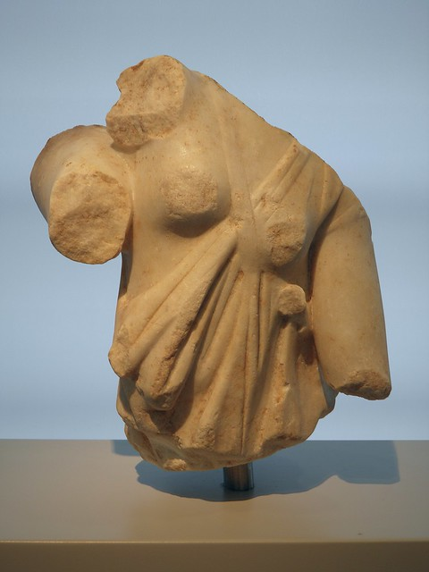 Part of a marble group, upper part of a female torso with a tunic that leaves bare the shoulder and one breast is preserved recognised as an Amazon, Philippi Museum