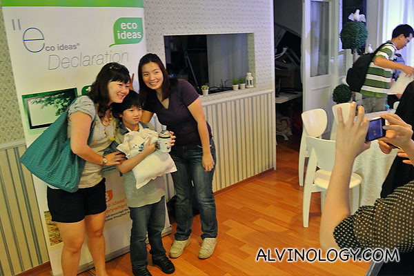 A little boy taking a photo with our working staff