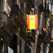 Barcelona side street with Spanish Flag