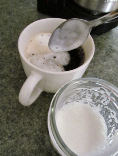 Spoon out milk foam