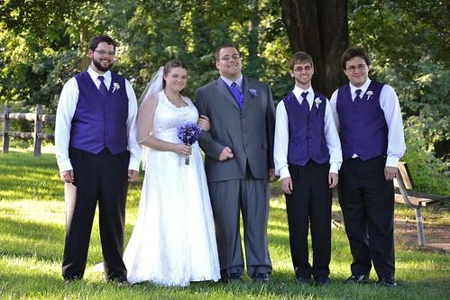 The happy couple with the groomsmen