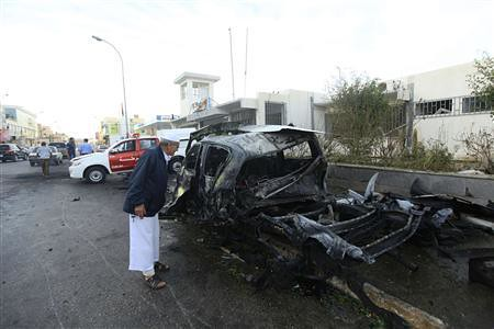 Man peers into vehicle damaged in a car bomb explosion outside a police building in Benghazi, Libya. Violence continues inside the country after the counter-revolution led by US imperialism and NATO. by Pan-African News Wire File Photos