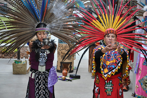 Dancers wearing indigenous Mexican regalia perform a traditional blessing at the grand opening of the Castle Rock Apartments in Boardman, Oregon, where 62 percent of the population is of Hispanic descent. The ceremony offered thanks to farm workers and likened the new apartment complex to a seed sprouting from the ground to bear fruit for the community.
