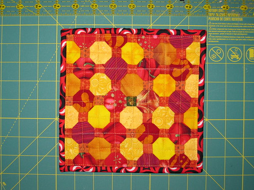 5 May 2012 - 19:23 - Assembled using English Paper Piecing (EPP) with an octagon-and-square pattern. The polygons are 1/2' on a side, the grid is in inches. The fabric is mostly from Amy's stash.  Made for: Amy