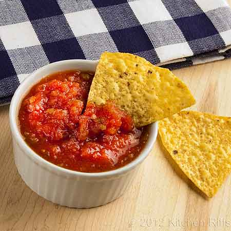 Picante Sauce with Jalapeño Garnish in White Ramekin and Tortilla Chips