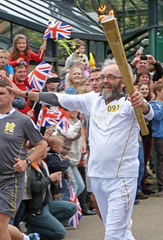 Frank Chislett bears the Olympic torch in Winding Road, Haifax by Tim Green aka atoach