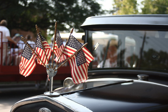 Flags are displayed on the hood of a restored Ford Model A.