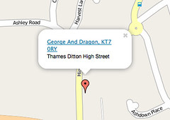 Screenshot of a small area of map showing a red pointer and a white info window reading 'George And Dragon, KT7 0RY, Thames Ditton High Street'.  The info window has a little triangle coming down from it and there is a small gap between this triangle and the red pointer.