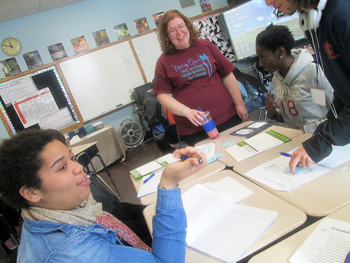 Students Nahja Mathis, Nottingham freshman and Finella Morgan, Jamesville-Dewitt senior, discuss their group manifesto with A. Wendy Nastasi during the Writing Our Lives workshop held Saturday, Nov. 3, 2012 at Nottingham High School.