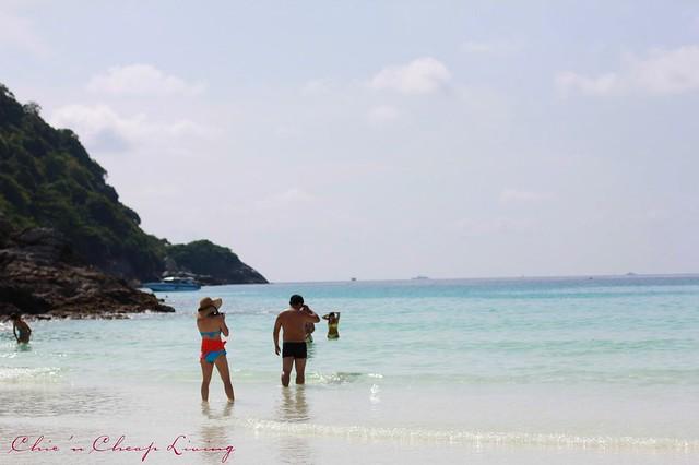 Raya Island people on beach by Chic n Cheap Living