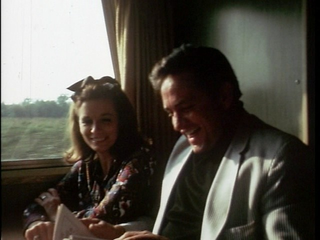 june carter cash and johnny cash share a laugh on the tour bus in a scene from johnny cash the. Black Bedroom Furniture Sets. Home Design Ideas