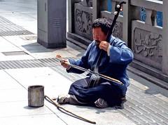 street artist, person, sitting,