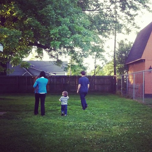 Kids (and Tina) check out the back yard for the first time