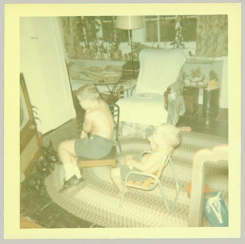 Two children watching TV