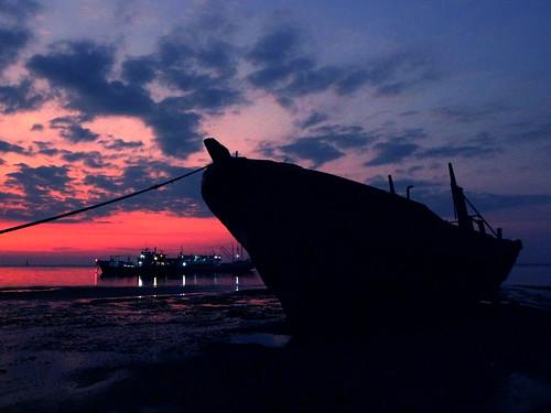 sunset sea ship tide timor dili