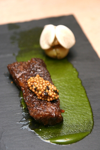 Grilled shortrib dusted with leek ash, topped with fresh mustard cooked in mushroom stock; eggplant caviar on potato; Piersiade sauce