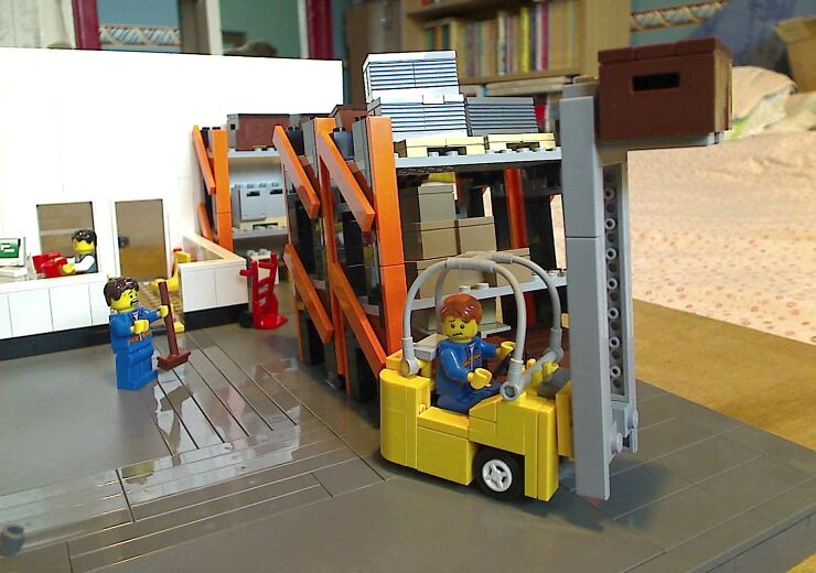 Forklift truck inside a LEGO® model of a warehouse