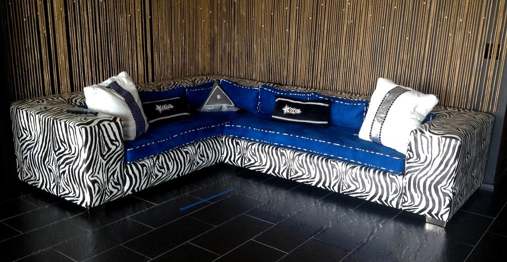 Sofas settees loveseats diva rocker glam for Zebra sectional sofa