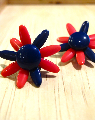 "Adorable 1950s plastic floral earrings with adjustable petals! Marked "" West Germany"""