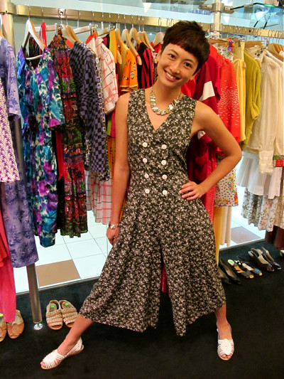 "Slide, slide, slide around in this ""double breasted"" 1980s jumpsuit. We like jumpsuits cos they let us be chor lor! Here, we're wearing it with a 1950s necklace and bracelet set. Swee!"