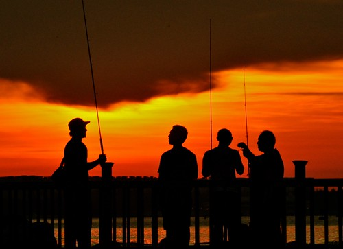 sunset silhouette fishing singapore changibeach