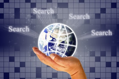 "Globe on crossword background surrounded by ""Search"""