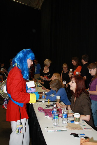 another male fan dressed as a different pony talks to Lauren Faust