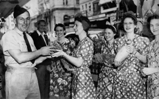 Liberty Week volunteers coaxing an airman into buying a pineapple, Queen Street Brisbane, November 1941