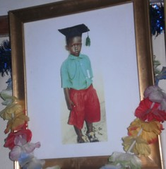At Santos and Leah's house, a picture of Gideon hangs on the wall