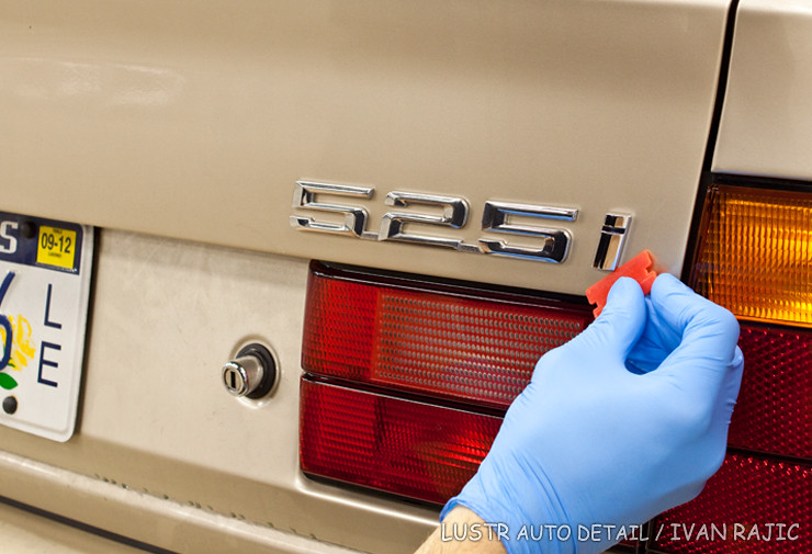 Using a plastic razor blade to remove 95 BMW 525i badge
