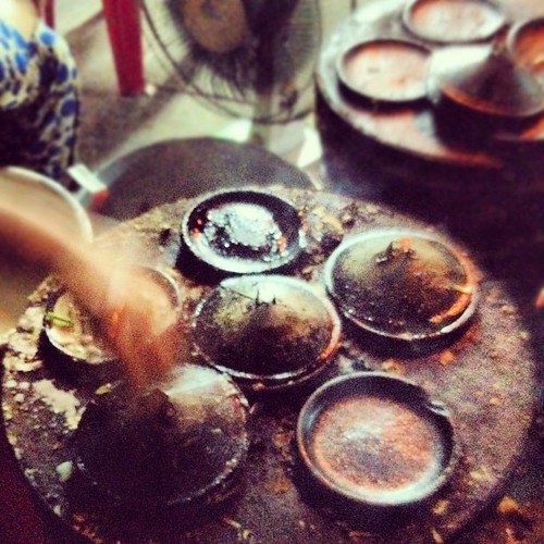 Something delicious baking under those lids. #StreetFood #NhaTrang #Vietnam #travelingram