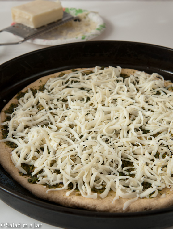 Showing layer of cheese on Chicken and Pesto Pizza
