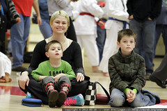 rachel & her boys, watching the karate demonstration…