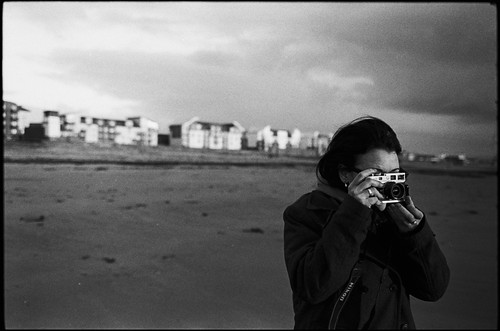 girl taking pictures on beach