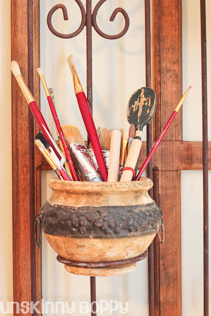 paint brushes in ceramic pot