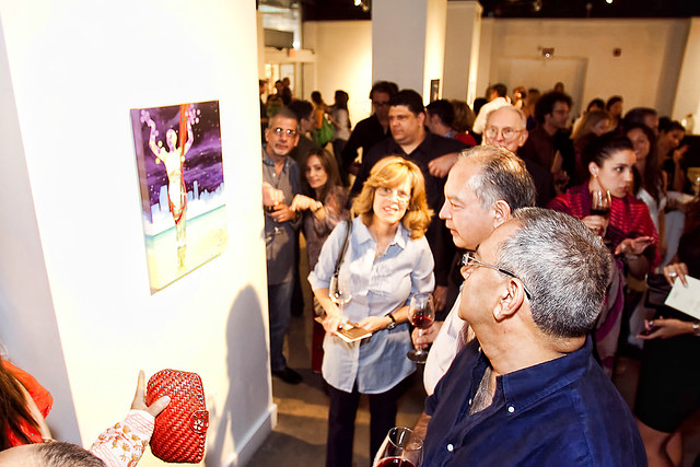 "Guests gather around the grand prize winner ""Jordan Wine Goddess"" at Jordan Winery's 4 on 4 Art Competition event at Bakehouse Art Complex in Miami"