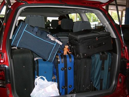 8 womens luggage in a Torago