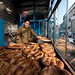 A man makes Naan bread in a stall in Kabul