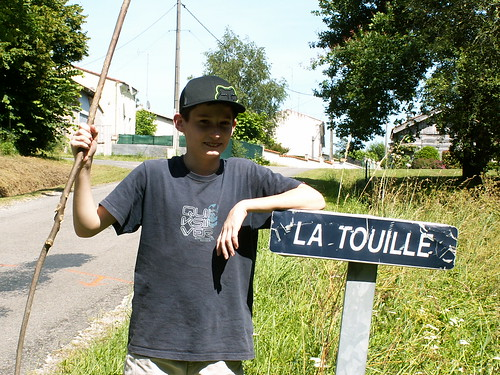Conrad with the village sign