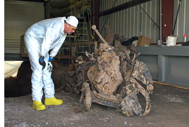 Excavator operator Kevin Miller looks at the remnants of a 1940s military truck buried in a Manhattan Project-era landfill