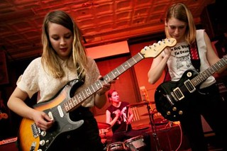 the members of Potty Mouth playing a show