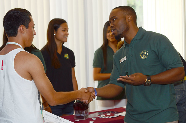 Chris Osuala greets a student.