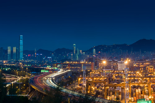 Blue hour view on Hong Kong, Kowloon and container terminal from Lai King by Mark Simons