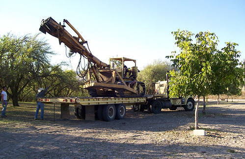A shaker truck near trees
